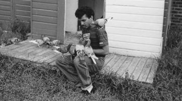 A young Warren with his birds